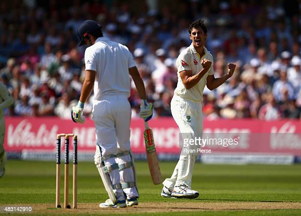 Mitchell Starc of Australia celebrates after taking the wicket of Alastair Cook of England during day one of the 4th Investec Ashes Test match...