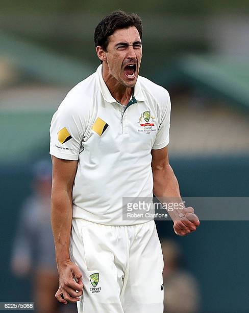 Mitchell Starc of Australia celebrates after taking the wicket of JeanPaul Duminy of South Africa during day one of the Second Test match between...