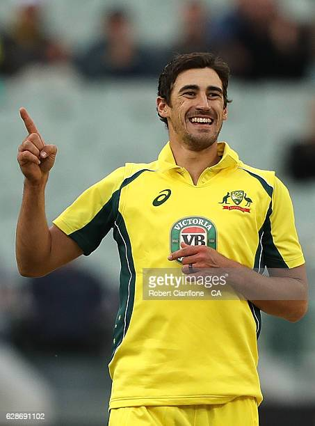 Mitchell Starc of Australia celebrates after taking the wicket of Henry Nicholls of New Zealand during game three of the One Day International series...