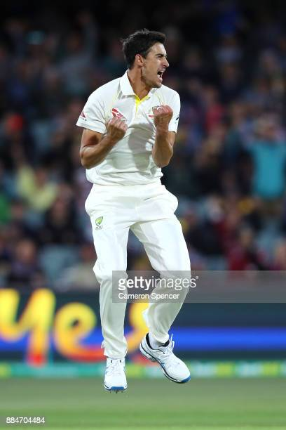 Mitchell Starc of Australia celebrates after taking the wicket of Mark Stoneman of England for lbw during day two of the Second Test match during the...