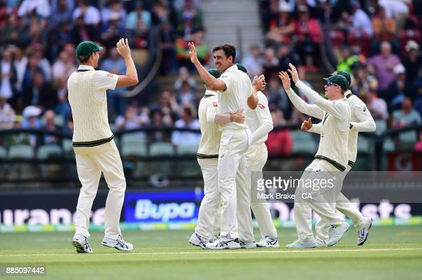 Mitchell Starc of Australia celebrates after taking the wicket of Jonny Bairstow of England during day three of the Second Test match during the...
