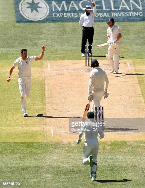 Mitchell Starc of Australia celebrates after taking the wicket of Craig Overton of England during day five of the Second Test match during the...