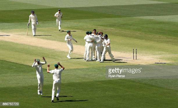 Mitchell Starc of Australia celebrates after taking the wicket of Jonny Bairstow of England to claim victory during day five of the Second Test match...