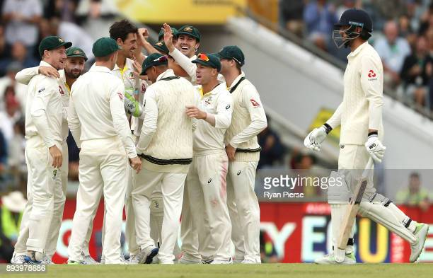 Mitchell Starc of Australia celebrates after taking the wicket of James Vince of England during day four of the Third Test match during the 2017/18...