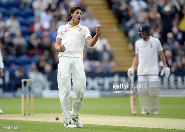 Mitchell Starc of Australia celebrates dismissing Ian Bell of England during day one of the 1st Investec Ashes Test match between England and...