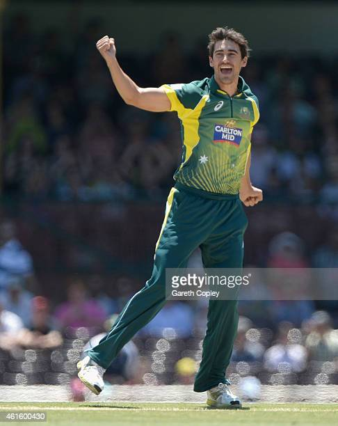 Mitchell Starc of Australia celebrates dismissing James Taylor of England during the One Day International series match between Australia and England...