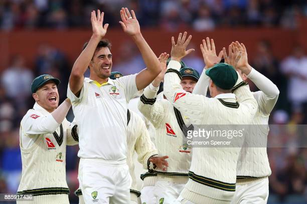 Mitchell Starc of Australia celebrates dismissing James Vince of England during day four of the Second Test match during the 2017/18 Ashes Series...
