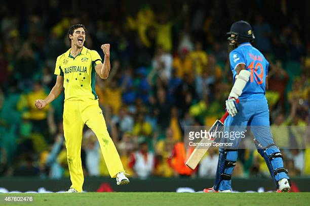 Mitchell Starc of Australia celebrates dismissing Umesh Yadav of India during the 2015 Cricket World Cup Semi Final match between Australia and India...
