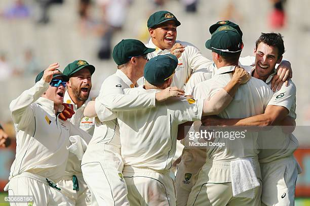 Mitchell Starc of Australia celebrates his last wicket of Yasir Shah with teammates to win the match during day five of the Second Test match between...