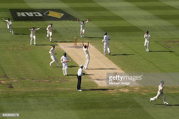 Mitchell Starc of Australia celebrates his last wicket of Yasir Shah to win the match during day five of the Second Test match between Australia and...