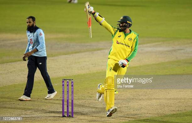 Mitchell Starc of Australia celebrates hitting the winning runs and victory as Adil Rashid of England looks dejected during the 3rd Royal London One...