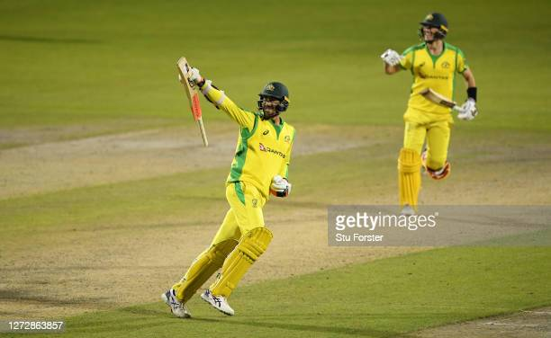 Mitchell Starc of Australia celebrates hitting the winning runs and victory during the 3rd Royal London One Day International Series match between...