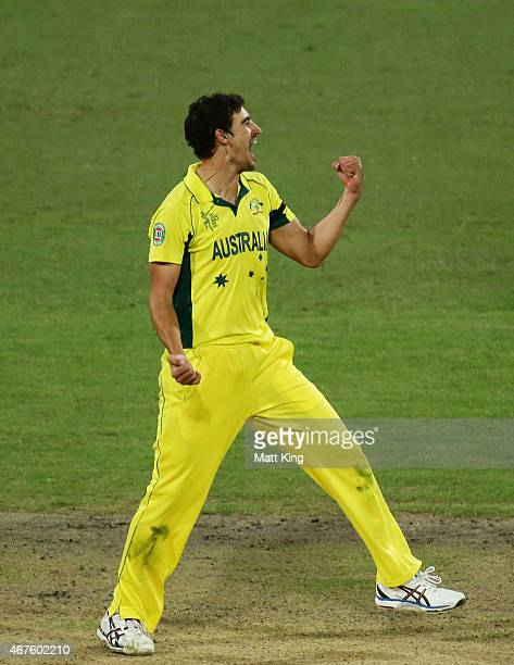 Mitchell Starc of Australia celebrates taking the final wicket of Umesh Yadav of India during the 2015 Cricket World Cup Semi Final match between...