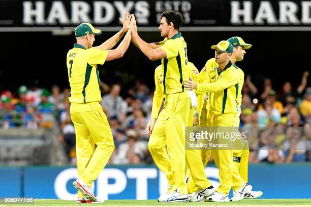 Mitchell Starc of Australia celebrates taking the wicket of Eoin Morgan of England during game two of the One Day International series between...