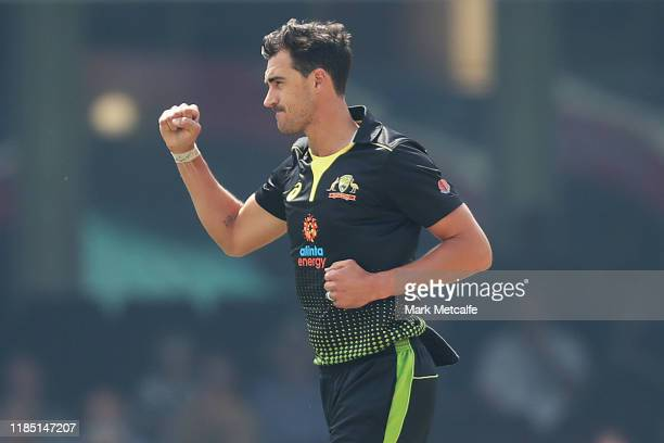 Mitchell Starc of Australia celebrates taking the wicket of Fakhar Zaman of Pakistan during game one of the International Twenty20 series between...