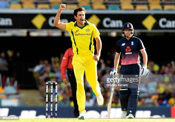 Mitchell Starc of Australia celebrates taking the wicket of Jason Roy of England during game two of the One Day International series between...