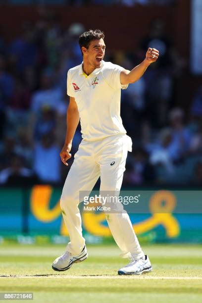 Mitchell Starc of Australia celebrates taking the wicket of Jonny Bairstow of England to win the test for Australia during day five of the Second...