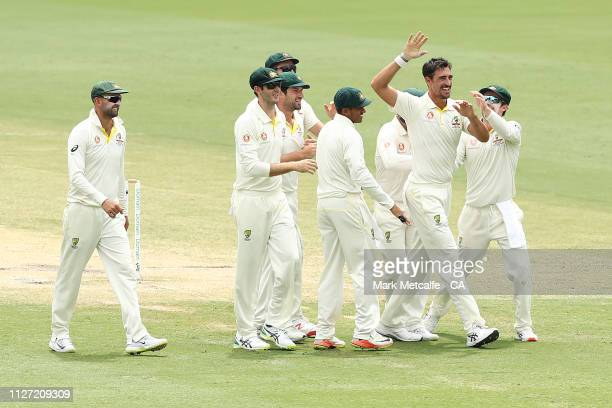 Mitchell Starc of Australia celebrates taking the wicket of Kusal Perera of Sri Lanka during day four of the Second Test match between Australia and...