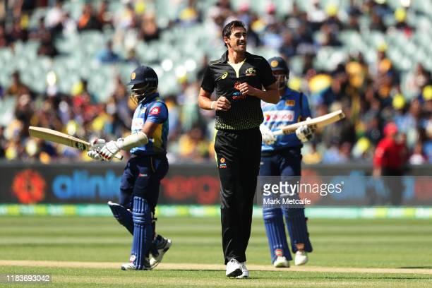 Mitchell Starc of Australia celebrates taking the wicket of Kusal Mendis of Sri Lanka during the Twenty20 International match between Australia and...