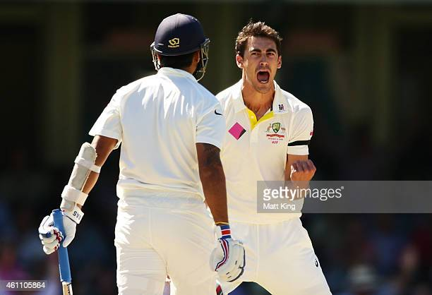 Mitchell Starc of Australia celebrates taking the wicket of Murali Vijay of India during day two of the Fourth Test match between Australia and India...