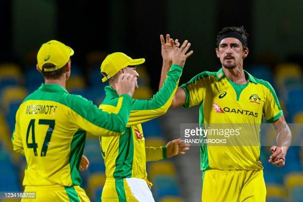 Mitchell Starc of Australia celebrates the dismissal of Darren Bravo of West Indies during the 2nd ODI between West Indies and Australia at...