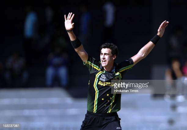 Mitchell Starc of Australia celebrates the dismissal of Pakistan Captain Mohammad Hafeez during the ICC T20 World Cup Super Eight group 2 cricket...