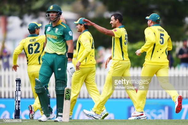 Mitchell Starc of Australia celebrates the wicket of Aiden Markram of South Africa during game three of the One Day International series between...