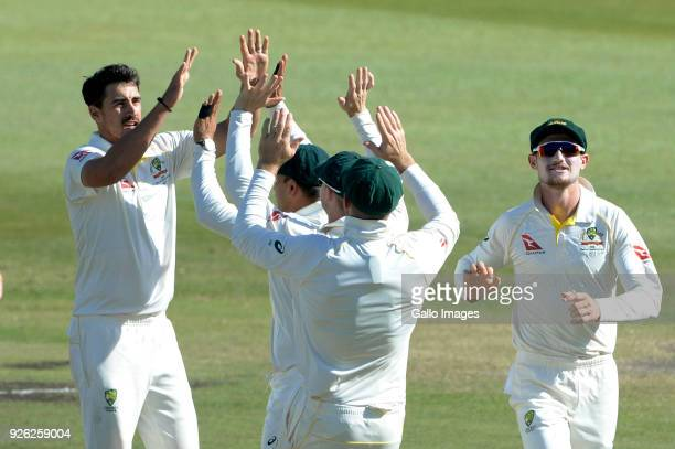 Mitchell Starc of Australia celebrates the wicket of Faf du Plessis of the Proteas with his team mates during day 2 of the 1st Sunfoil Test match...