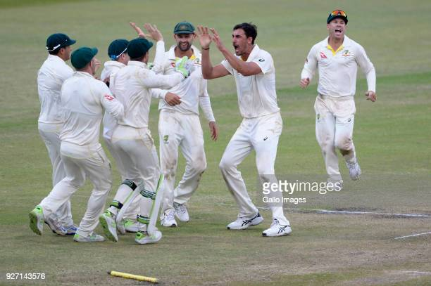 Mitchell Starc of Australia celebrates the wicket of Kagiso Rabada of the Proteas during day 4 of the 1st Sunfoil Test match between South Africa and...