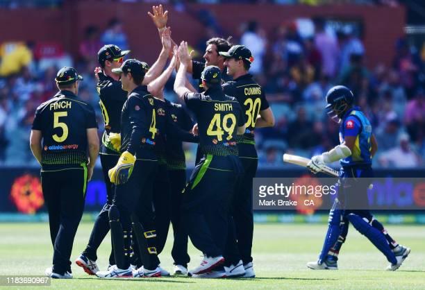 Mitchell Starc of Australia celebrates the wicket of Kusal Mendis of Sri Lanka during the Twenty20 International match between Australia and Sri...