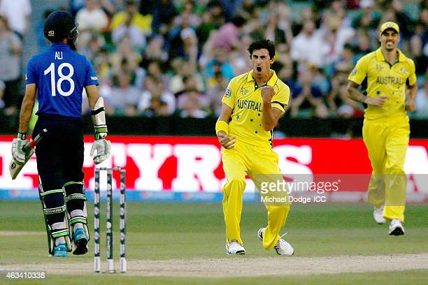 Mitchell Starc of Australia celebrates the wicket of Moeen Ali of England during the 2015 ICC Cricket World Cup match between England and Australia...