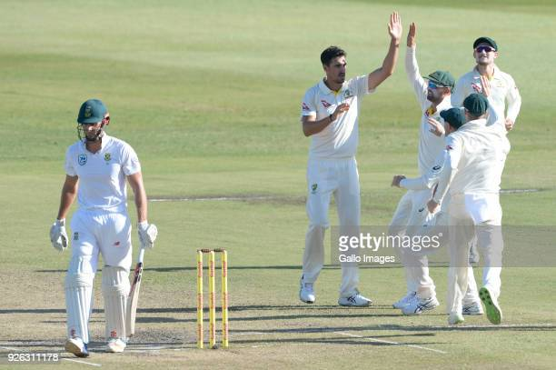 Mitchell Starc of Australia celebrates the wicket of Theunis de Bruyn of the Proteas with his team mates during day 2 of the 1st Sunfoil Test match...