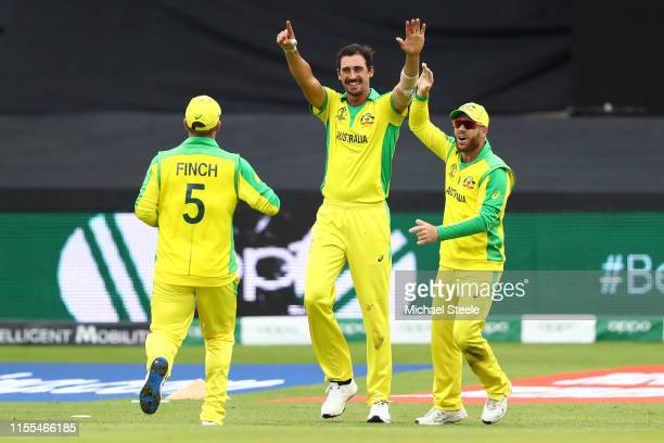 Mitchell Starc of Australia celebrates with Aaron Finch and David Warner after taking the wicket on review of Wahab Riaz during the Group Stage match...