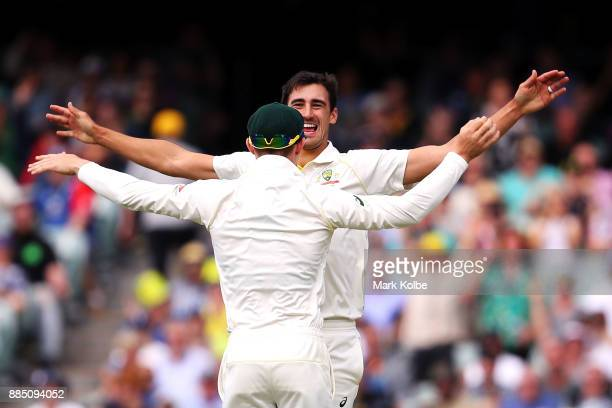 Mitchell Starc of Australia celebrates with Cameron Bancroft of Australia after taking the wicket of Jonny Bairstow of England during day three of...