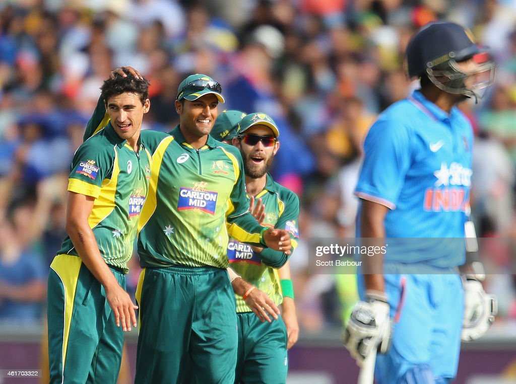 Mitchell Starc of Australia celebrates with Gurinder Sandhu and Glenn Maxwell after dismissing Akshar Patel of India during the One Day International match between Australia and India at the Melbourne Cricket Ground on January 18, 2015 in Melbourne, Australia.