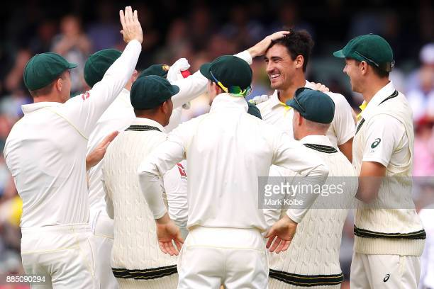 Mitchell Starc of Australia celebrates with his team after taking the wicket of Jonny Bairstow of England during day three of the Second Test match...