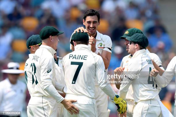 Mitchell Starc of Australia celebrates with his team mates after taking the wicket of Haris Sohail of Pakistan during day one of the 1st Domain Test...