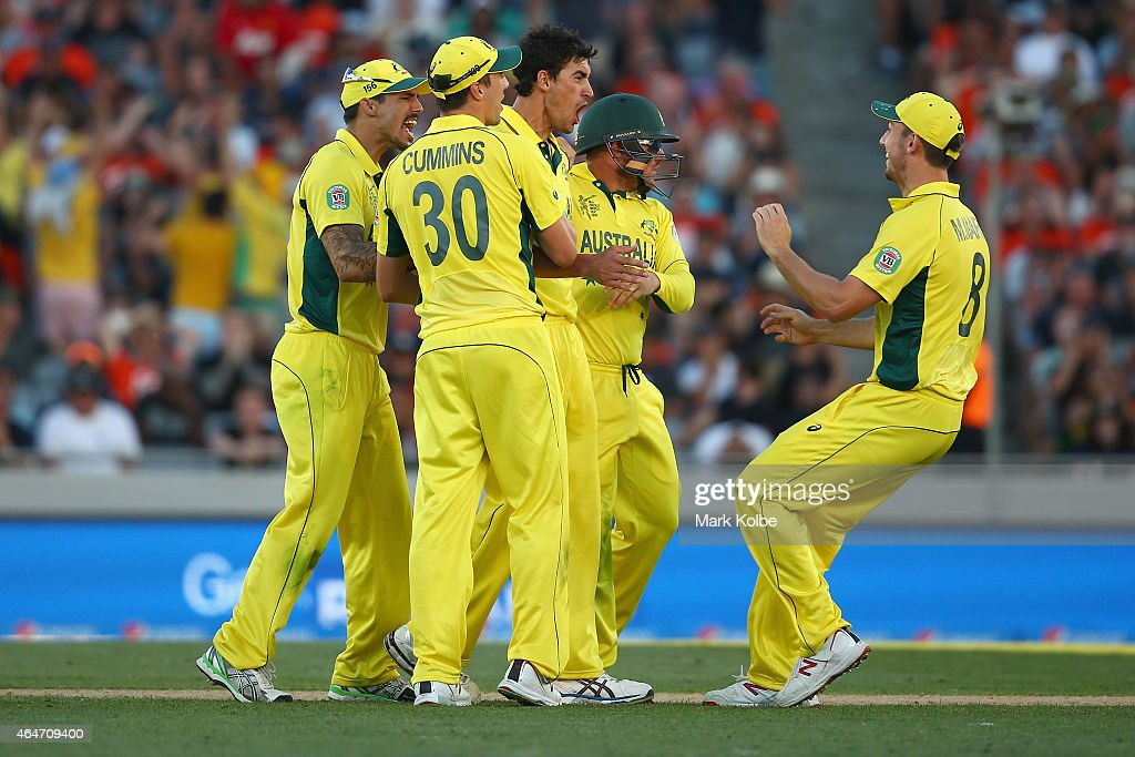 Mitchell Starc of Australia celebrates with his team mates after taking the wicket of Tim Southee of New Zealand during the 2015 ICC Cricket World Cup match between Australia and New Zealand at Eden Park on February 28, 2015 in Auckland, New Zealand.