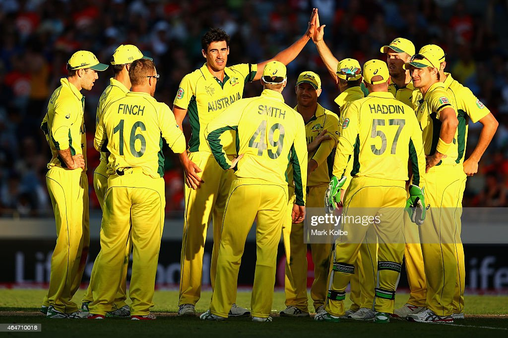 Mitchell Starc of Australia celebrates with his team mates after taking the wicket of Luke Ronchi of New Zealand during the 2015 ICC Cricket World Cup match between Australia and New Zealand at Eden Park on February 28, 2015 in Auckland, New Zealand.