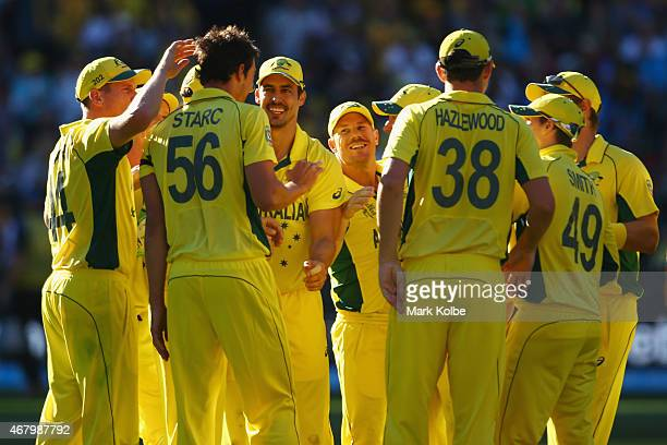 Mitchell Starc of Australia celebrates with his team mates after taking the wicket of Luke Ronchi of New Zealand during the 2015 ICC Cricket World...