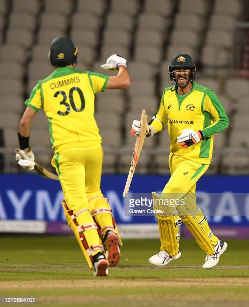 Mitchell Starc of Australia celebrates with Pat Cummins of Australia after hitting the winning runs in the 3rd Royal London One Day International...