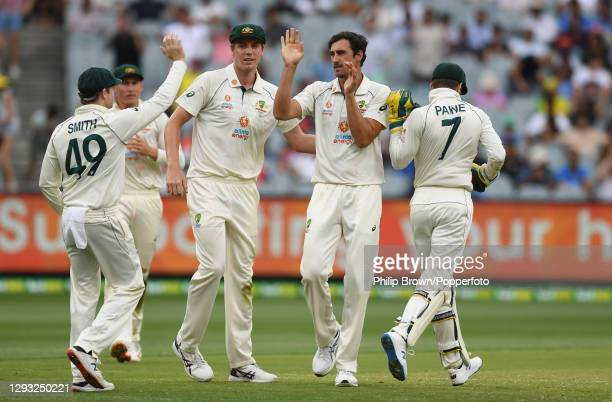 Mitchell Starc of Australia celebrates with Steve Smith, Cameron Green and Tim Paine after dismissing Rishabh Pant during day two of the Second Test...