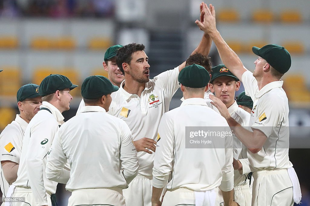 Mitchell Starc of Australia celebrates with team mates after dismissing Sami Aslam of Pakistan during day three of the First Test match between Australia and Pakistan at The Gabba on December 17, 2016 in Brisbane, Australia.