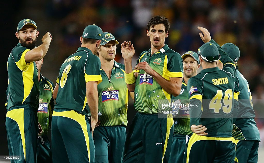 Mitchell Starc (C) of Australia celebrates with team mates after taking the wicket of Dale Steyn of South Africa during game three of the One Day International Series between Australia and South Africa at Manuka Oval on November 19, 2014 in Canberra, Australia.