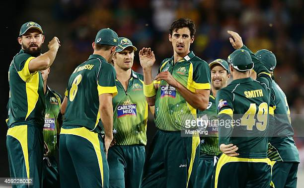 Mitchell Starc of Australia celebrates with team mates after taking the wicket of Dale Steyn of South Africa during game three of the One Day...