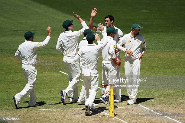 Mitchell Starc of Australia celebrates with team mates after dismissing Vernon Philander of South Africa during day four of the Third Test match...