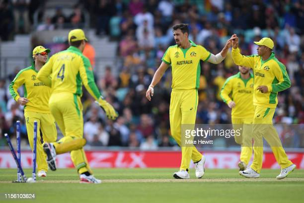 Mitchell Starc of Australia celebrates with team mates aftert bowling Kusal Perera of Sri Lanka during the Group Stage match of the ICC Cricket World...