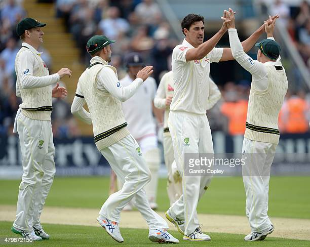 Mitchell Starc of Australia celebrates with teammates after dismissing Ian Bell of England during day one of the 1st Investec Ashes Test match...