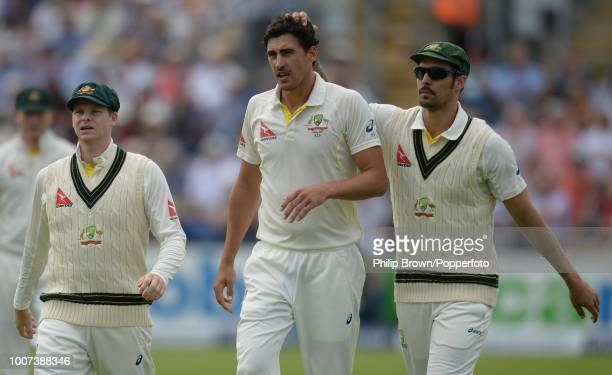 Mitchell Starc of Australia congratulated by teammate Mitchell Johnson after dismissing Moeen Ali of England during the 1st Ashes Test match between...