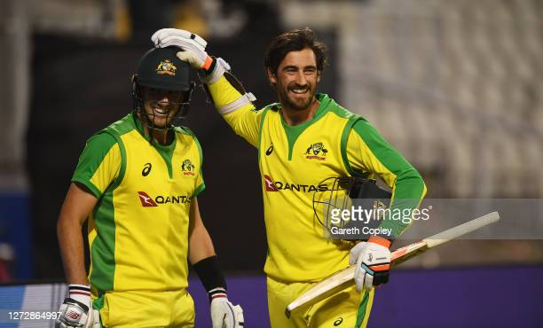Mitchell Starc of Australia embraces Pat Cummins of Australia after victory in the 3rd Royal London One Day International Series match between...